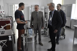 In the Laboratory of Temperature In the Laboratory of Temperature - four men standing and talking